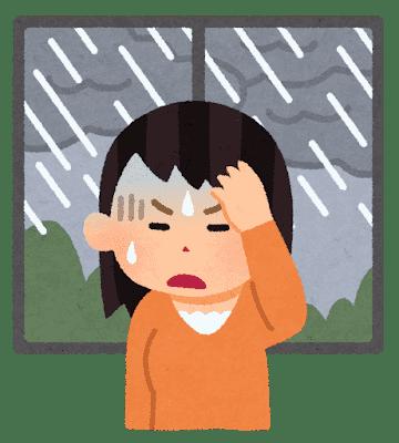 気象病 天気痛に苦しむ女性